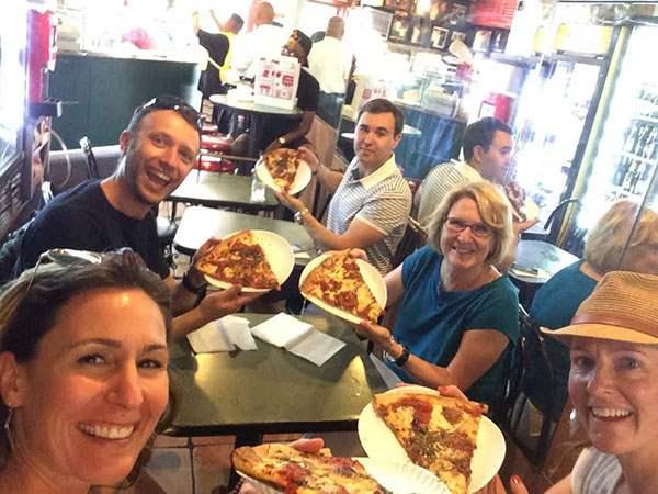 Enjoying a slice of pizza at Bleecker Street Pizza
