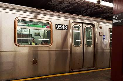 F Train in the station at 57th street