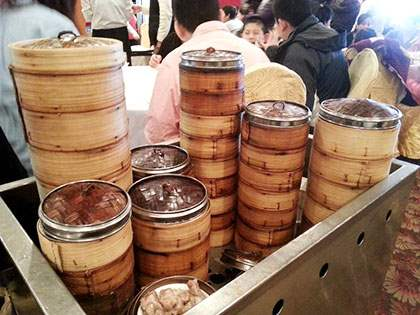 Steaming bamboo containers with bite-size dim sum