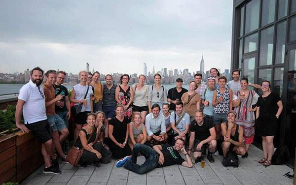 Swedish corporate group atop Wythe rooftop